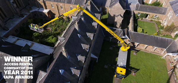 Bronto S50XDJ cherry picker stretching over houses