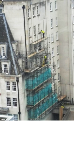 Scaffolder could face jail after being photographed 60ft up wearing a harness that wasn't attached to anything