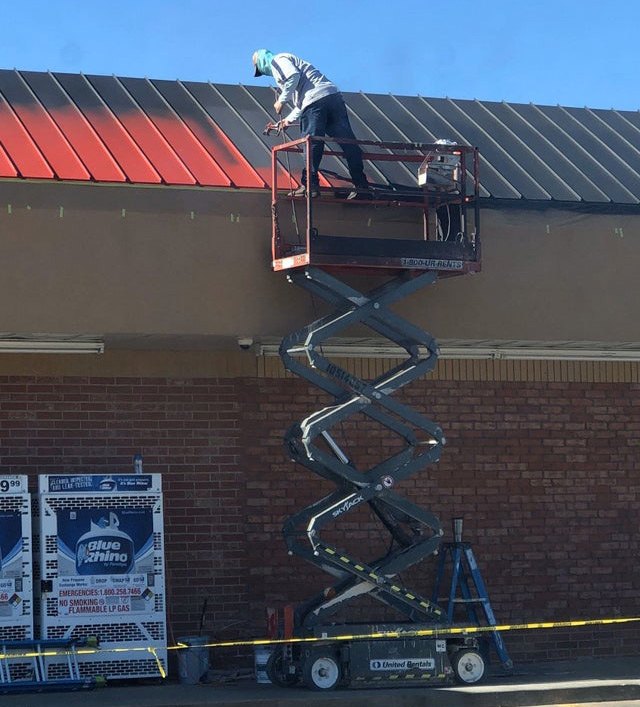 Picture of Painting while balancing on scissor lift rails is a bad idea