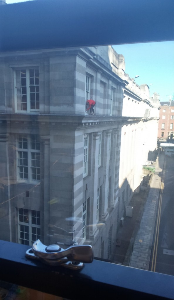 Picture of Cleaning windows in high heels, and not even a harness!