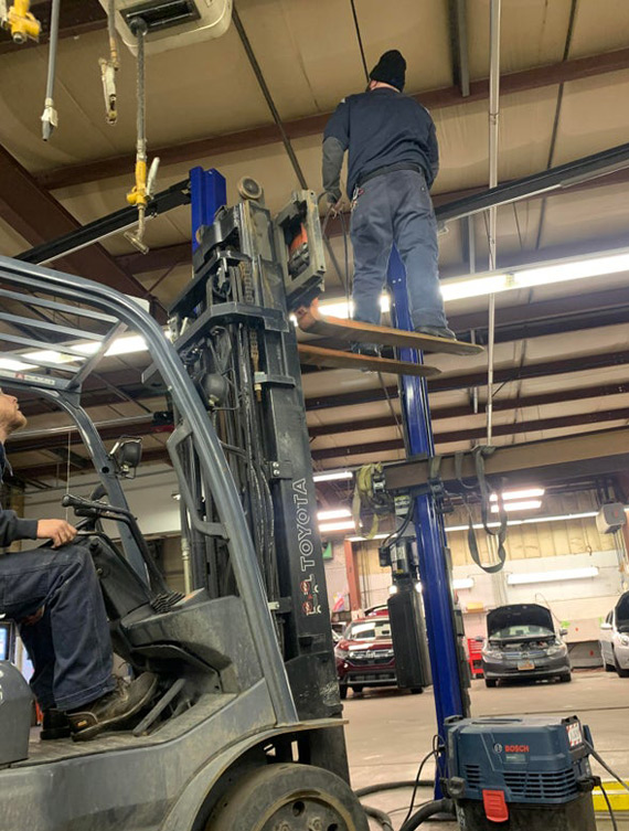 Picture of Balancing on forklift tines is a good way to have an accident
