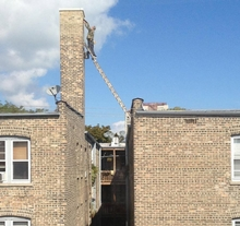 Terrifying chimney work. Get the proper equipment and save your life!