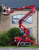 Cherry picker used on rough terrain